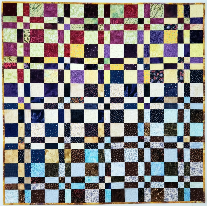 Disappearing 4-patch variation color flow scrap quilt. From the article, Color Concepts in Scrap Quilts