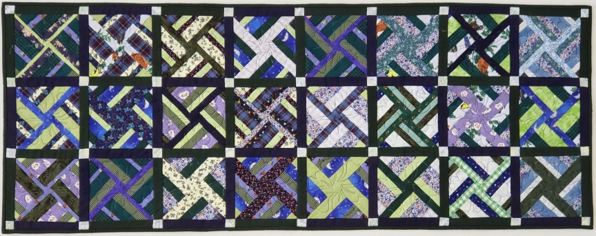 Green and blue string quilt. From the article, Color Concepts in Scrap Quilts