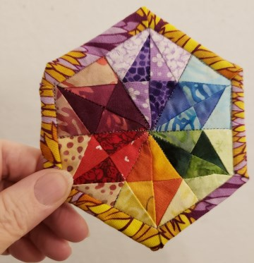 Mini Prismatic Quilt, from the article on making quilts from small scraps