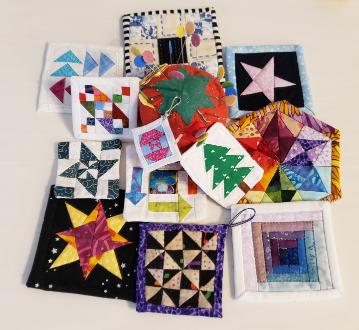 Many mini mini quilts