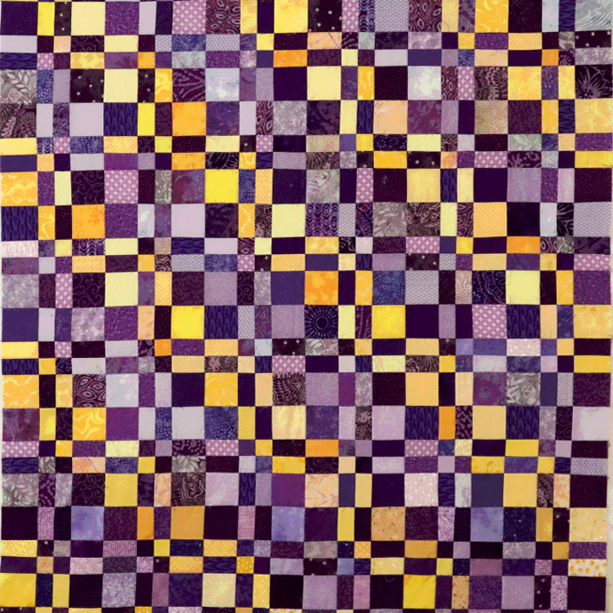 Purple and Yellow Disappearing 4-Patch quilt